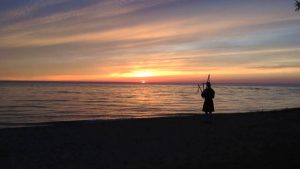 The Sunset Piper Pipes Down the Sunset @ on Southampton's beach at the flag (by Dominion Lookout, near Millard Boulevard/High Street)